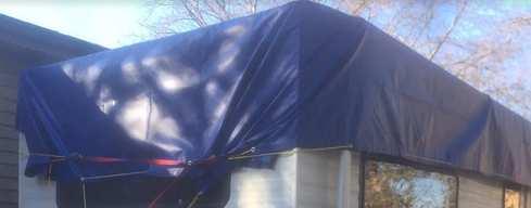 Flat tarp gathered at the end