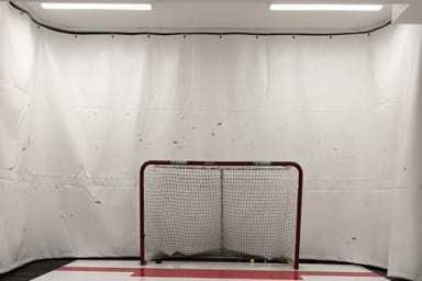 Tarp used as a background in hockey practice