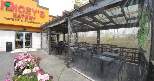 Clear roll-up tarps used for restaurant patio