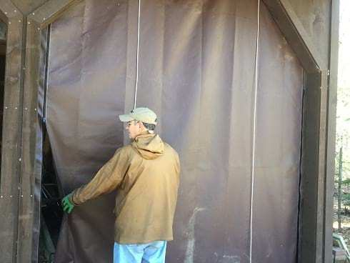 Roll-up shed door tarp