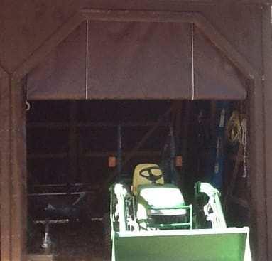 Tarp used for barn door