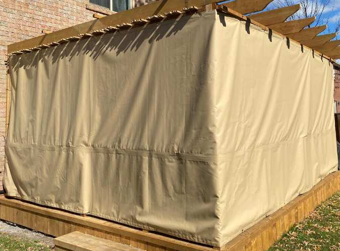 Sukkah with tan tarp covering