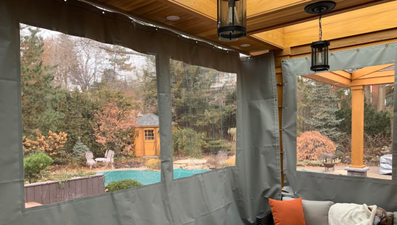 Sun room tarps to close in a deck area