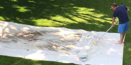 Tarp cleaning with a brush