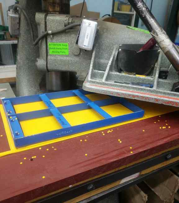 Tarp cut using a die and press