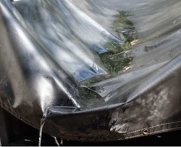 Water draining off of a trailer tarp