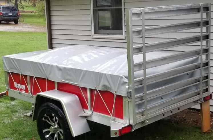Utility trailer with a ramp