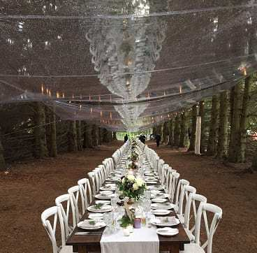 Tarps used to keep guests dry at a wedding